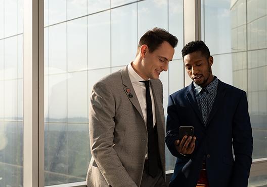 Businessmen talking in formal wear