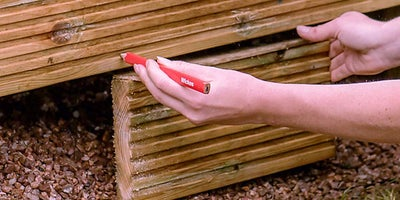 59.How-To-Build-A-Raised-Deck-Adding-fascia-board-Step-4.jpeg