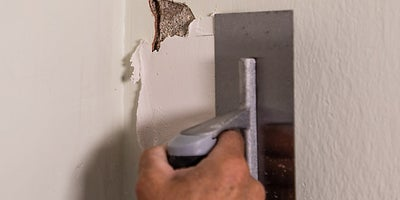5.How-To-Repair-Walls-Patch-Plaster-5.jpeg