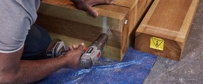 Step30_Man_Drilling_Wood.jpeg