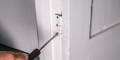 12.How-To-Fix-Door-Problems-Packing-Hinge.jpeg