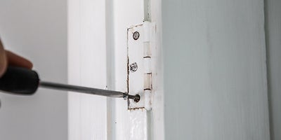 5.How-To-Fix-Door-Problems-Loose-Hinge.jpeg