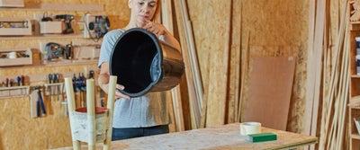 10.Woman_holding_bucket.jpeg
