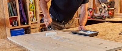 87.Applying_adhesive_on_timber.jpeg