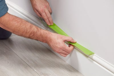 Protect skirting with masking tape