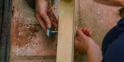 17.How-To-Lay-A-Deck-Adding-A-Wall-Plate15.jpeg