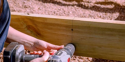 27.How-To-Build-A-Raised-Deck-Adding-joists-Step-3.jpeg
