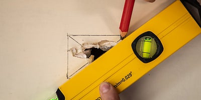 12.how-To-Repair-Walls-Small-Hole-5.jpeg