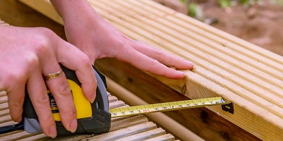 53.How-To-Build-A-Raised-Deck-Finishing-the-steps-Step-5.jpeg