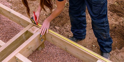 36.How-To-Build-A-Raised-Deck-Building-the-steps-Step-1.jpeg