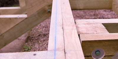 43.How-To-Build-A-Raised-Deck-Building-the-steps-Step-8.jpeg