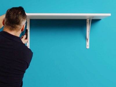 Man putting up a shelf