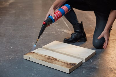 Ignite your blowtorch and move across the wood