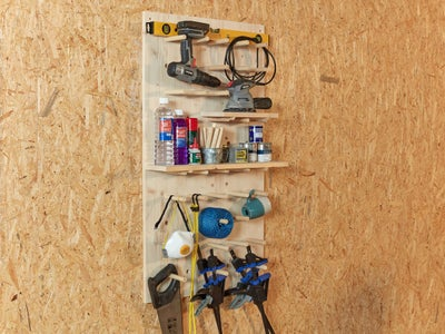 35._Collection_of_tools_stored_on_pegboard.jpg