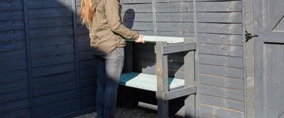 9.Fitting_Wooden_Fence_in_Garden.jpeg