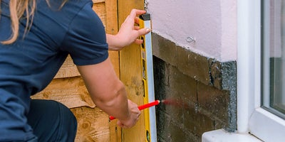 4.How-To-Lay-A-Deck-Adding-A-Wall-Plate2.jpeg