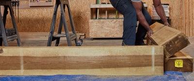 Step16_Man_Picking_up_Timber.jpeg