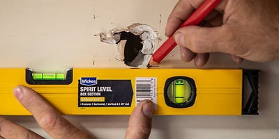 11.How-To-Repair-Walls-Small-Hole-4.jpeg