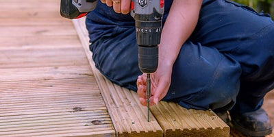 55.How-To-Build-A-Raised-Deck-Finishing-the-steps-Step-7.jpeg