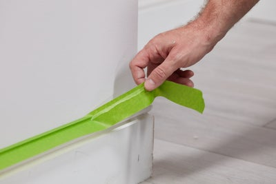 Protect the skirting with masking tape