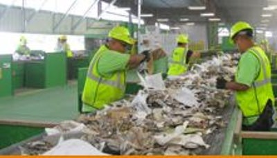 People sorting on a recycling conveyor belt
