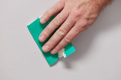 Sandpaper the surface smooth