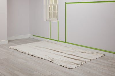 Cover the floor with a dust sheet