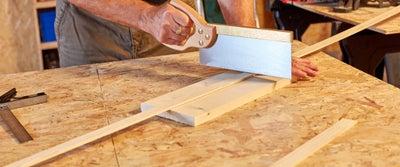 19.Cutting_wood_with_saw.jpeg