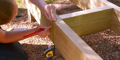 34.How-To-Build-A-Raised-Deck-Adding-noggings-Step-2.jpeg