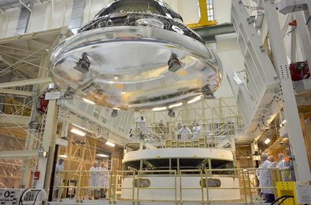 Pictured is the Orion crew module for Exploration Flight Test-1 in the final assembly and system testing (FAST). It's positio