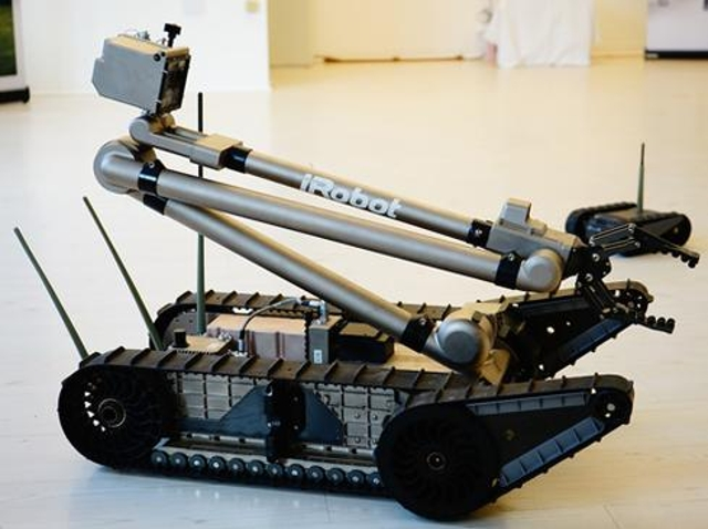 Roomba on the battlefieldThe line between remote control and autonomy can be blurry. Take the uPoint Multi-Robot Control (MRC
