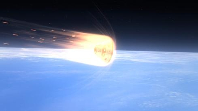 This computer-generated art shows Orion's heat shield protecting the crew module during entry into Earth's atmosphere. The he