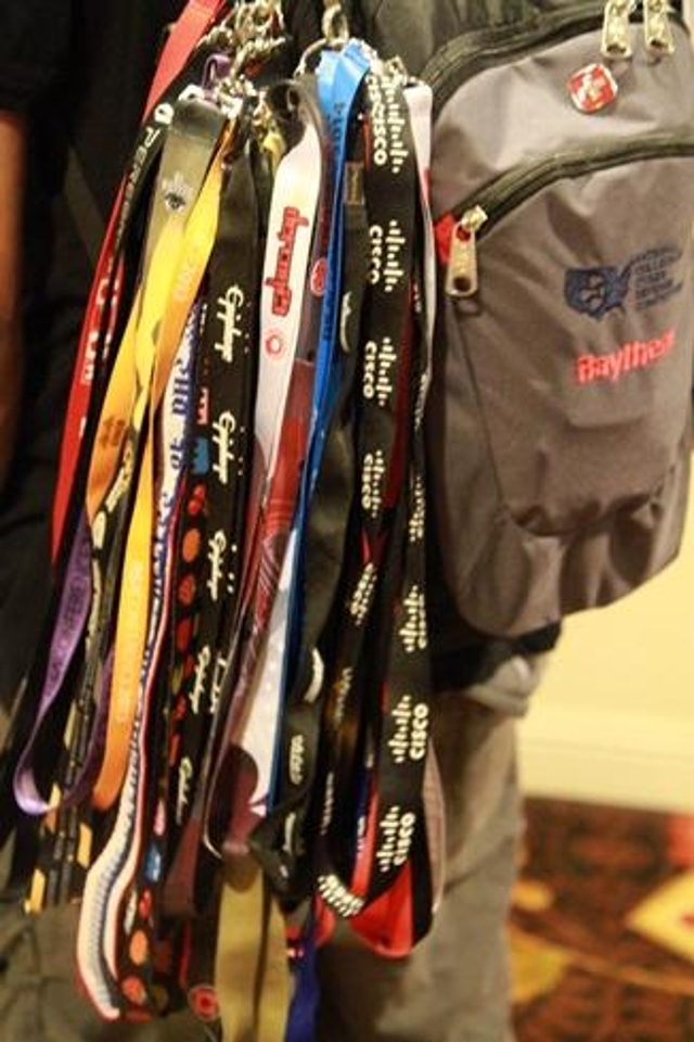 A collection of lanyards from DEF CONs past adds some bling to an attendee's backpack.