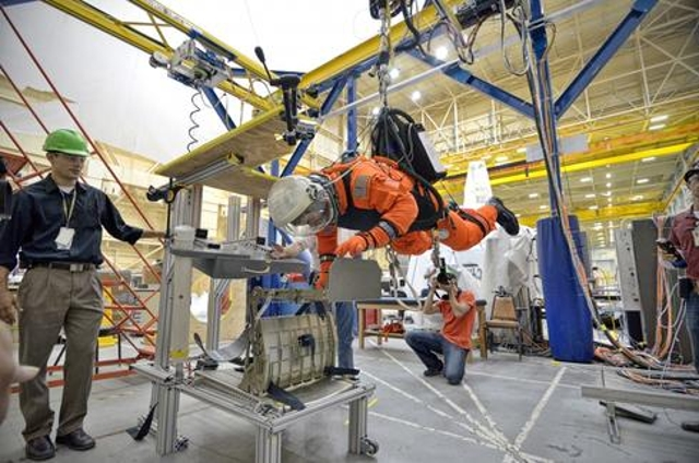 Here a NASA astronaut participates in an evaluation of the Advanced Crew Escape Suit (ACES) at the Johnson Space Center. The