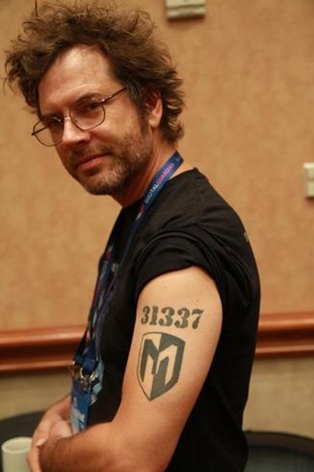 "Metasploit Framework manager Tod Beardsley of Rapid7 rocks his literally ""leet"" tattoo at Black Hat USA."