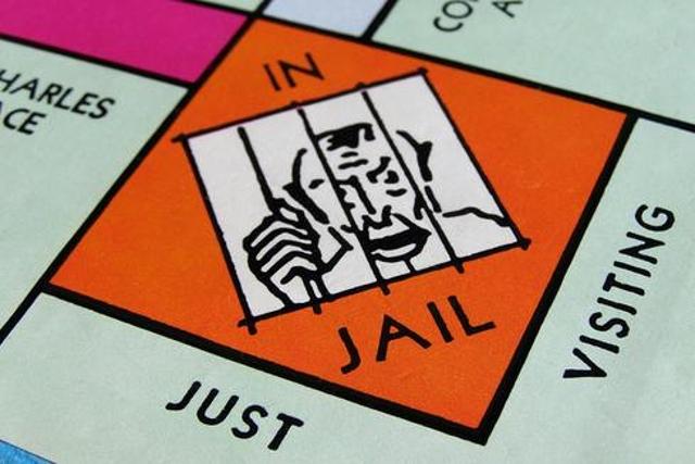 """Monopoly In Jail"" by StockMonkeys.com"