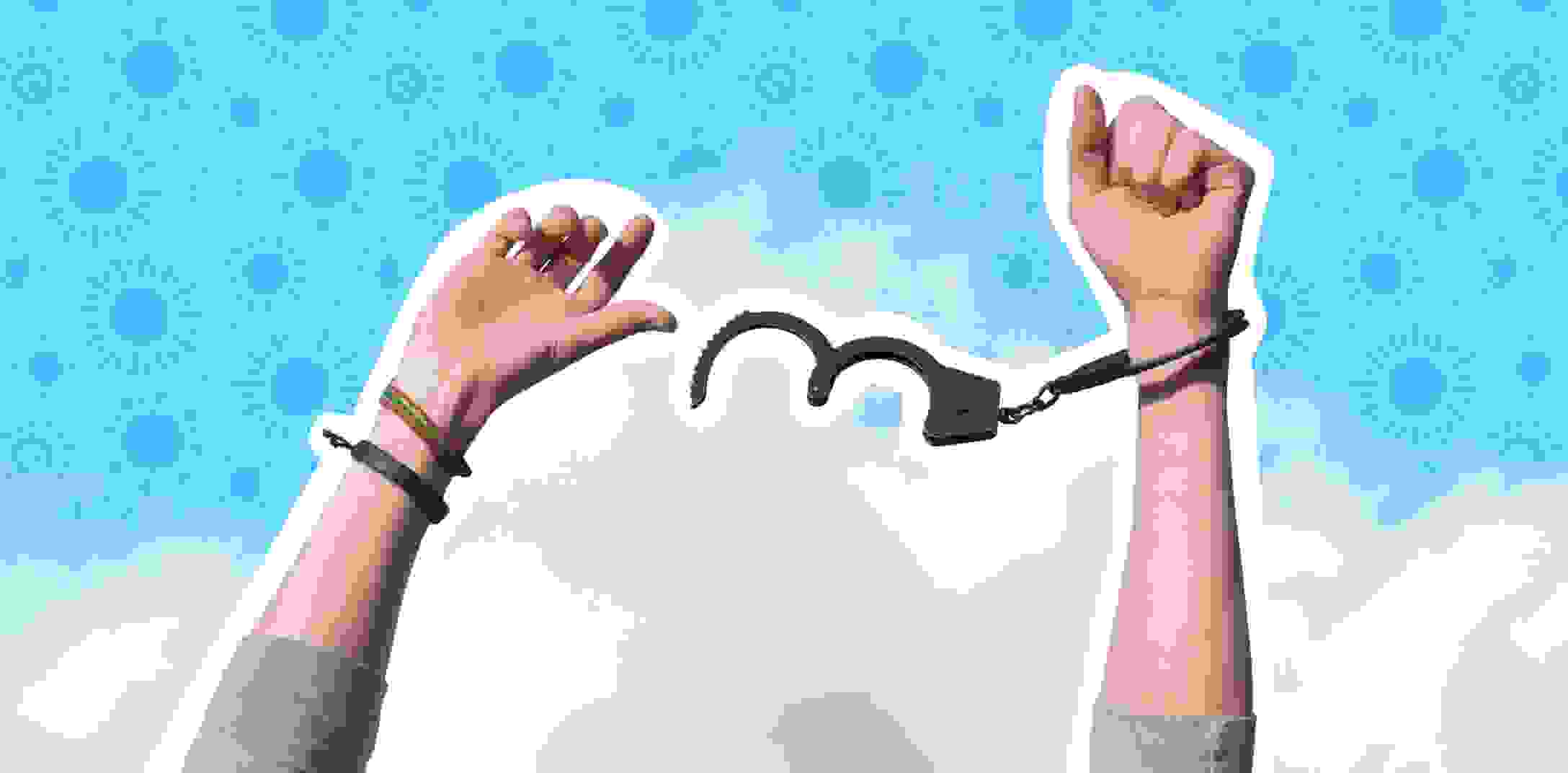 Hands breaking free from handcuffs