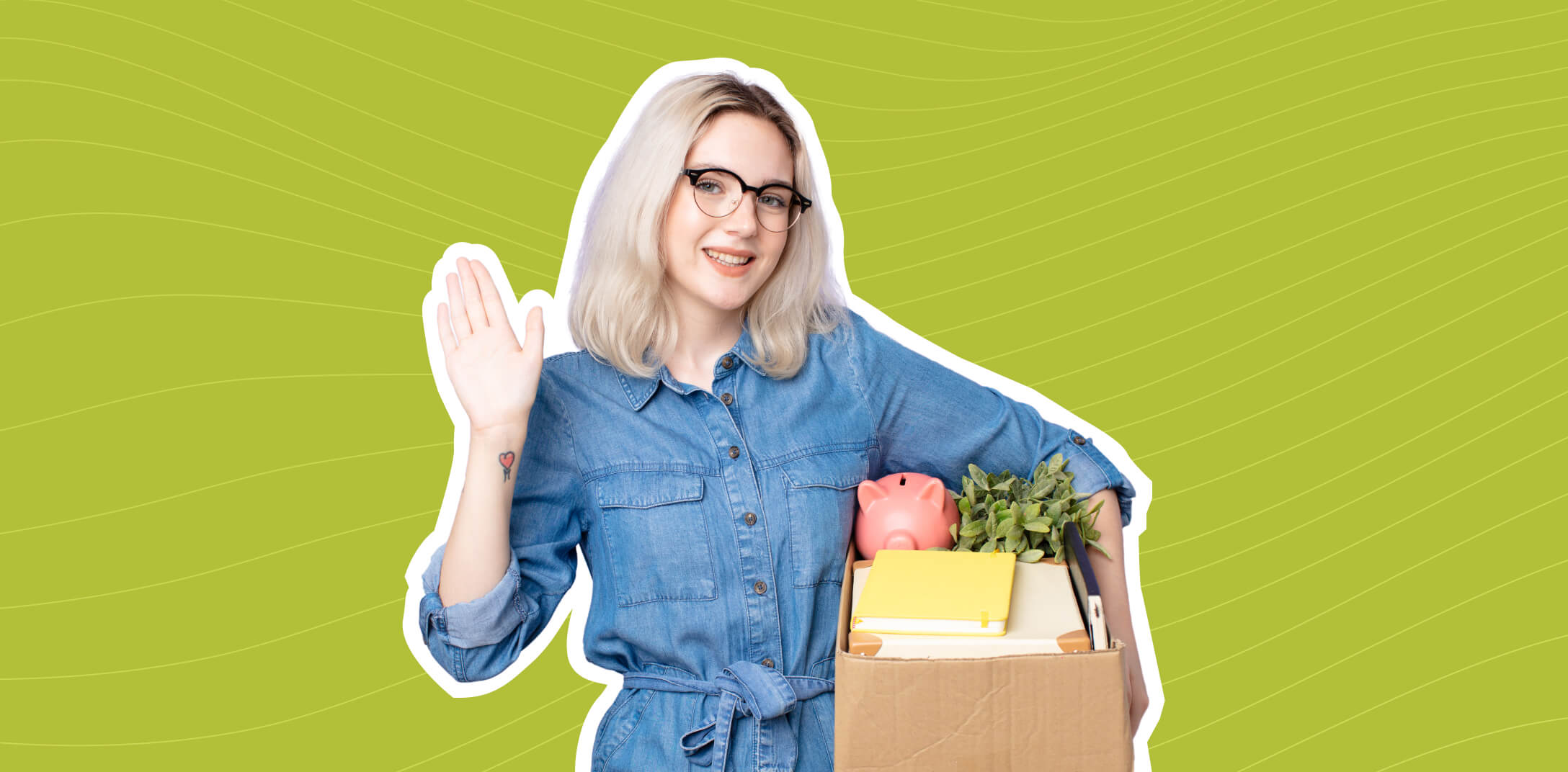 A woman holding a box with personal possessions