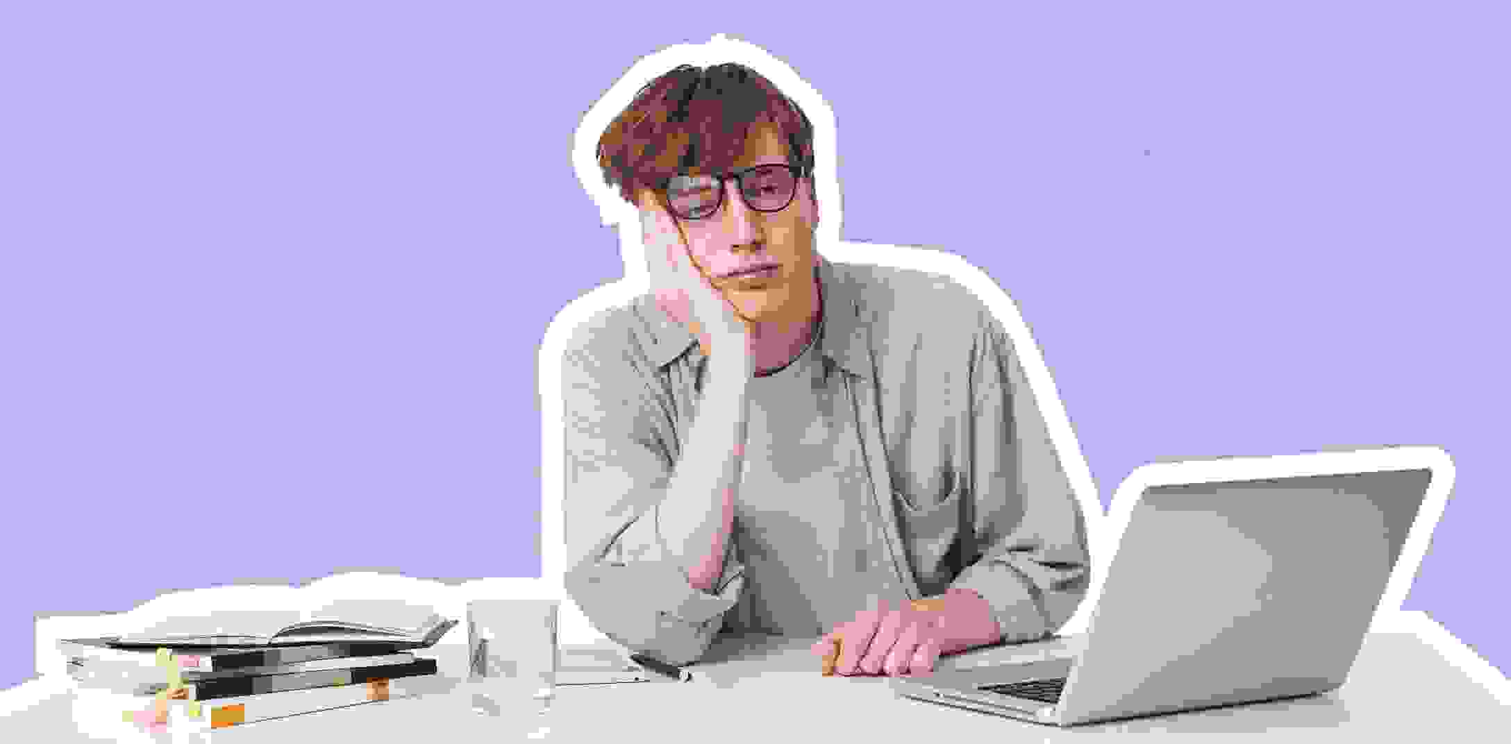 Bored man sits in front of his laptop