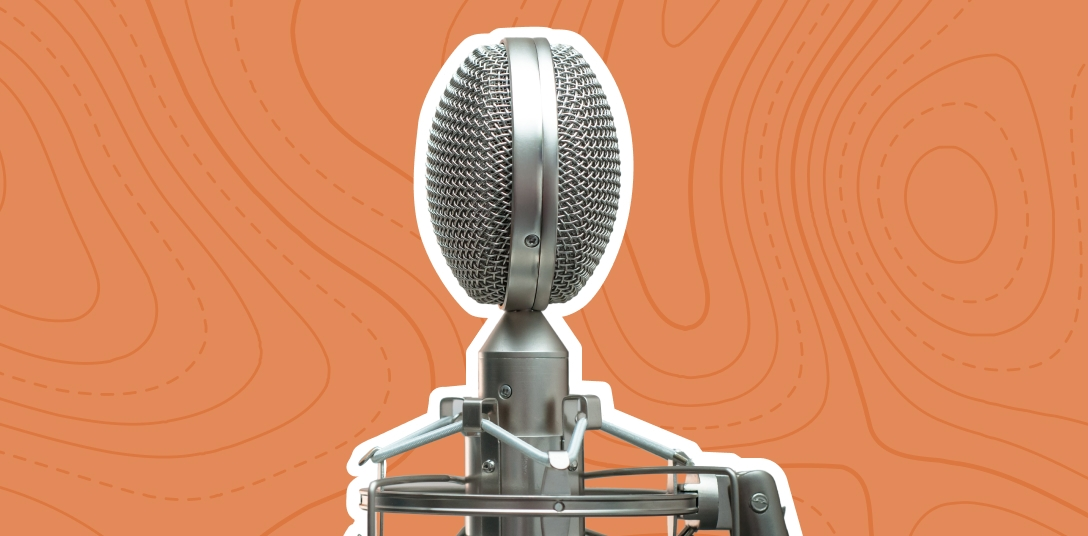 A microphone on the orange background