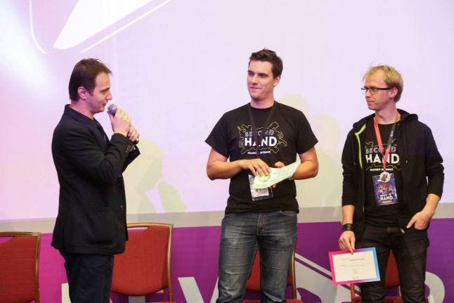 Team Rikodu receiving the prize for the Dev.Play Indie Pitch Challenge