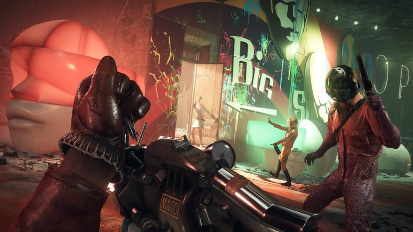 A first-person screenshot of Colt reloading a nail-using gun while three enemies look approach.