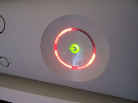 """An Xbox360 console displaying the infamous """"Red Ring of Death"""""""