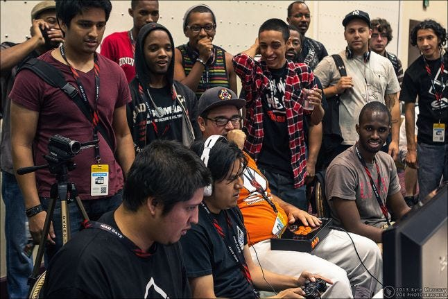 Carlos Vasquez playing competitively, surrounded by a smiling audience