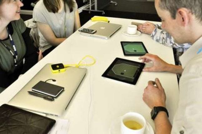 two people playtesting ipad single switch games