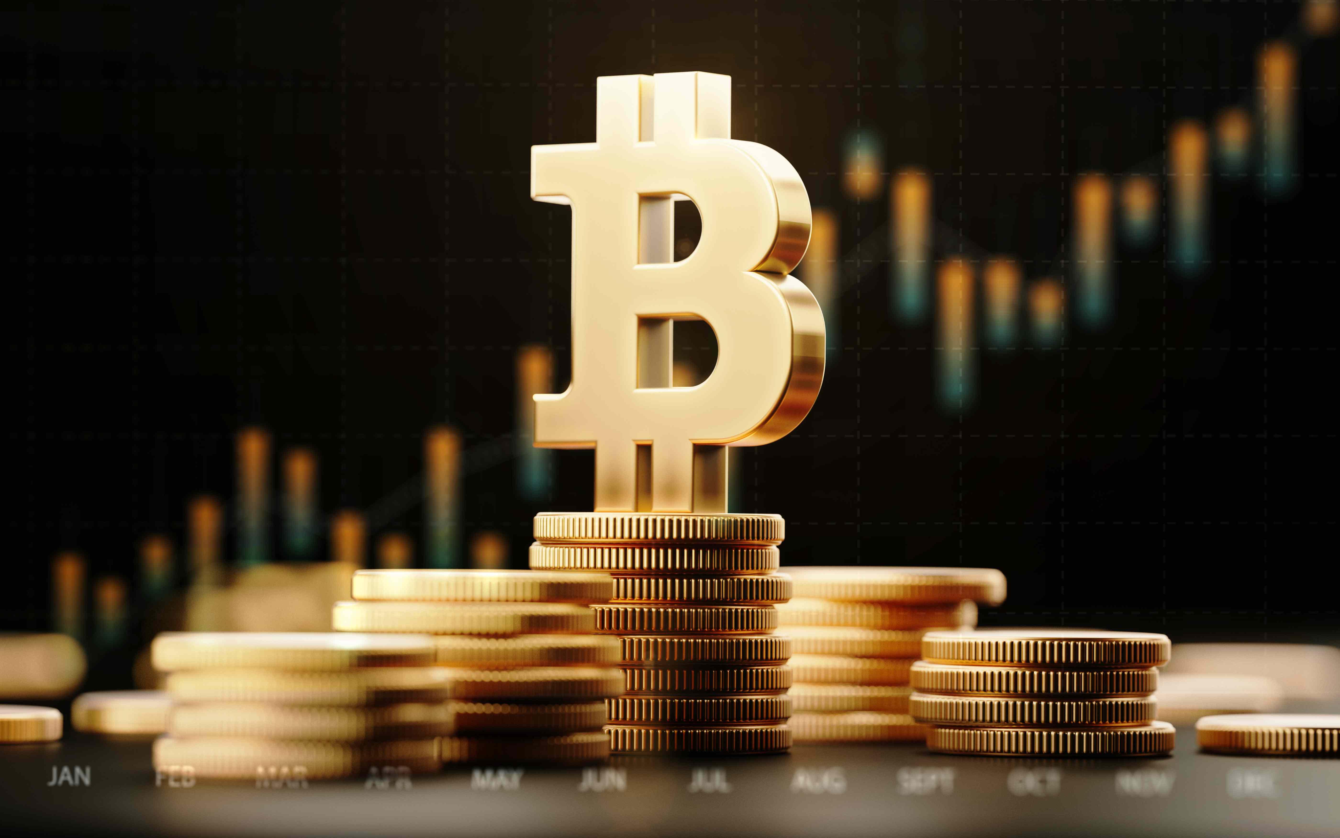 Gold bitcoin logo on stack of gold Bitcoin tokens