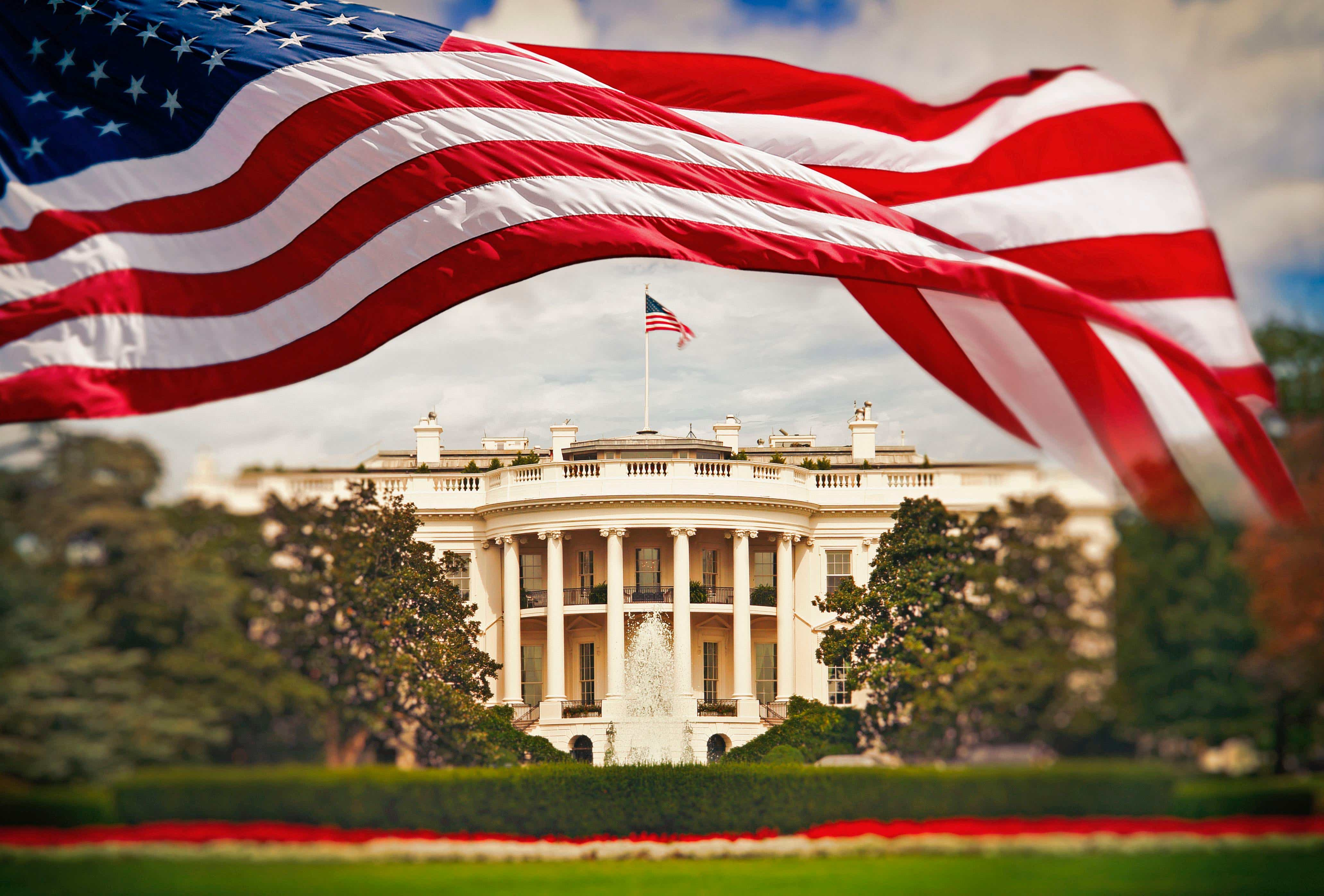 US flag and White House
